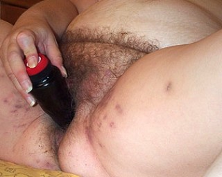 This big lady loves to play with her hairy pussy
